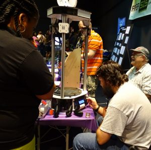 Photo of Ray, Sean, and a 3D printer at Maker Faire 2014 by Kalyan Mysore